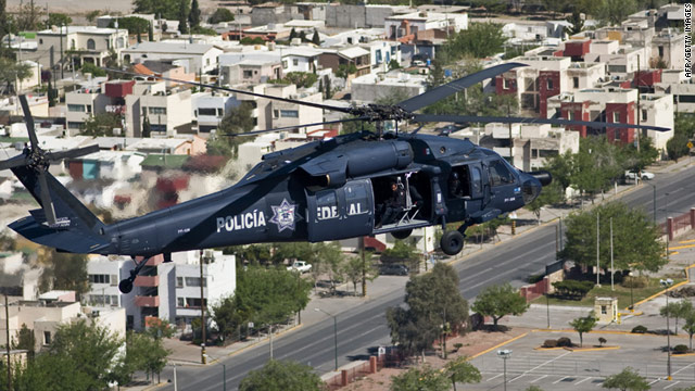 A Mexican police helicopter patrols the skies over Ciudad Juarez.