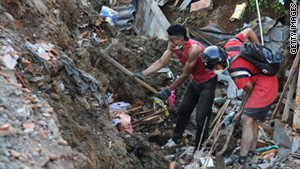 Dozens of homes were buried in a landslide near Medellin, Colombia, over the weekend.