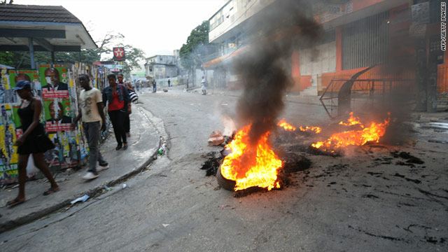 Protesters light fires in the streets of Haiti's capital Port-au-Prince after the release of initial election results, December 8, 2010.