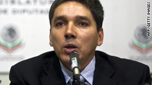 Julio Cesar Godoy is accused of ties with drug traffickers and has been stripped of his legislative duties.