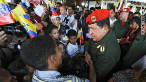 Venezuelan President Hugo Chavez greets people affected by rains at Fuerte Tiuna military base on Tuesday.