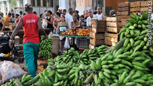 Cubans line up to buy farm food at a market in Havana May 2.