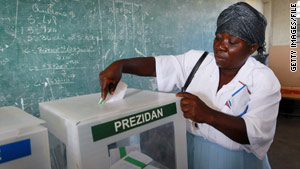 A voter casts her ballot in Haiti's national election on November 28 in Port-au-Prince.