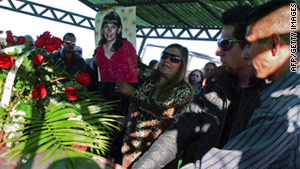 Relatives of Marisela Escobedo stand next to her coffin during her funeral in Ciudad Juarez, Mexico, on Saturday.