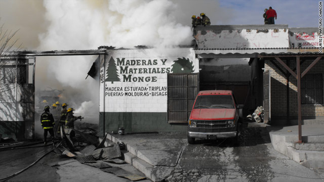 A lumber business owned by Manuel Monge, boyfriend of slain activist Marisela Escobedo, burns on Saturday.