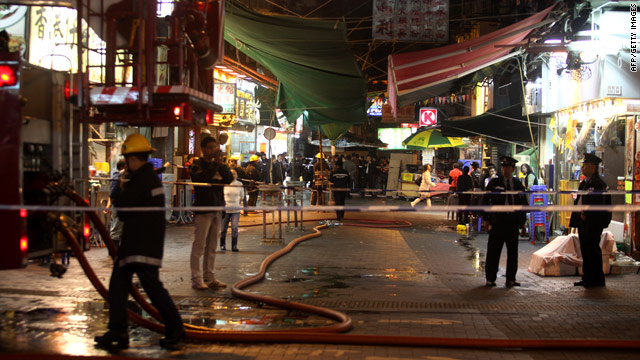 Police cordon off the scene of Saturday night's acid attack in Hong Kong.