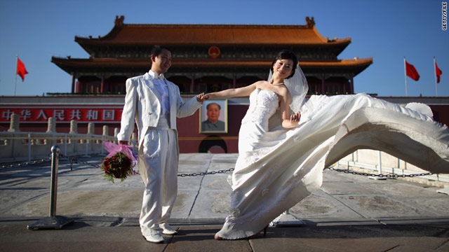 Newlyweds in front of the Tiananmen Gate, Beijing, China in September 2009.