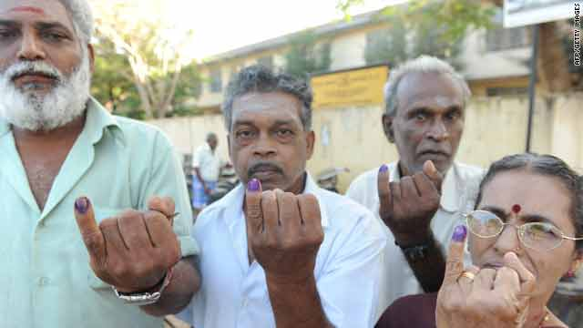 War displaced ethnic Tamils show their inked fingers after voting in Vavuniya, Sri Lanka, on Tuesday.