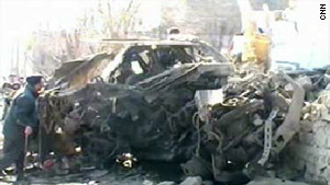 Burnt, mangled metal is all that remains of a vehicle after Wednesday's bomb blast in Pakistan.