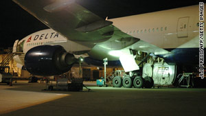 A mechanic found the body of a man in the landing gear bay of this Boeing 777 that landed in Tokyo, Japan, on Sunday.