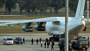 The cargo plane sits on the tarmac at the airport in Bangkok after being intercepted in December.