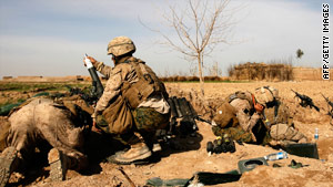 U.S. Marines fire a mortar as they battle insurgents in the northeast of Marjah on Friday.