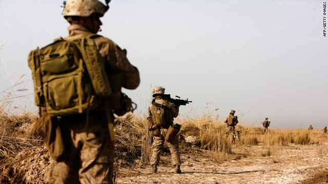 U.S. Marines patrol Sunday in the northeast of Marjah, Afghanistan, controlled for years by militants and drug traffickers.