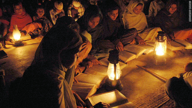 According to an independent power expert, over 40 per cent of India's population still depends on kerosene for lighting, such as these children using lanterns on the grounds of their school.