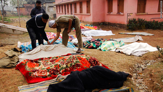 Blankets cover bodies in West Bengal state's West Midnapore district, where the attack took place.