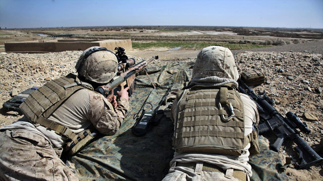 U.S. Marines stand guard as U.S. and Afghan forces set up a base in Helmand province on Thursday.