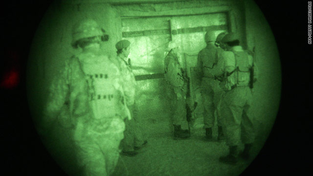 U.S. soldiers, with Afghan troops and national police, look for Taliban insurgents during a night raid in Ghazni province.