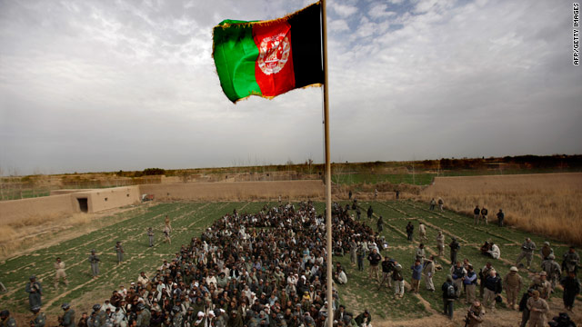The Afghan national flag is raised during a ceremony in Marjah, Afghanistan, on Thursday.