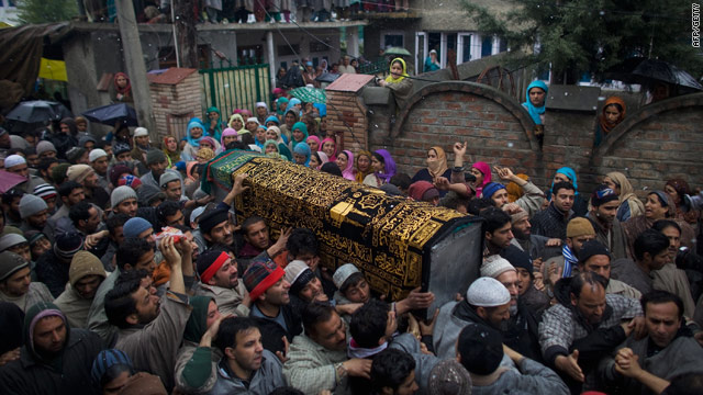 Mourners carry the body of teenager Zahid Farooq  Sheikh for burial on February 6