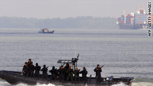 Malaysian authorities carry out an anti-piracy drill in the Strait of Malacca.