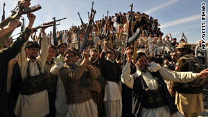 Pakistani tribal militias celebrate with soldiers in the Bajaur region on Tuesday.