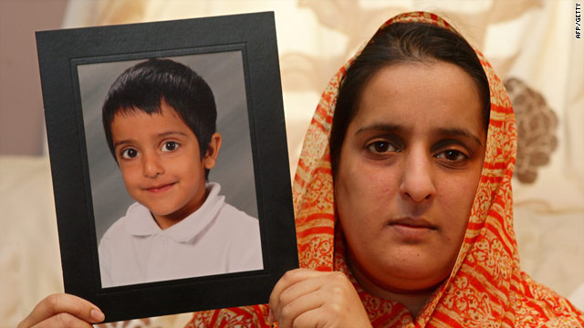 Akila Naqqash with a picture of Sahil Saeed  in Oldham, England. Her son was kidnapped during a vacation in Pakistan.