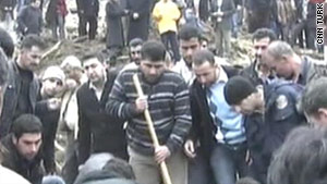 Turkish television showed civilians digging with shovels in the rubble of collapsed buildings.