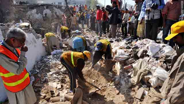 Volunteers search for victims Monday in the rubble of a destroyed building after a suicide attack in Lahore, Pakistan.