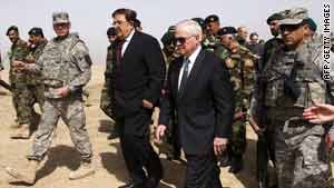Robert Gates, center right, and Afghan Defense Minister Abdul Rahim Wardak tour Camp Blackhorse on Wednesday.
