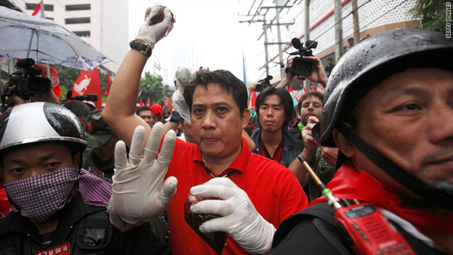 A protester holds blood in a plastic bag to be thrown during a protest near Thailand PM's Abhisit Vejjajiva's residence.