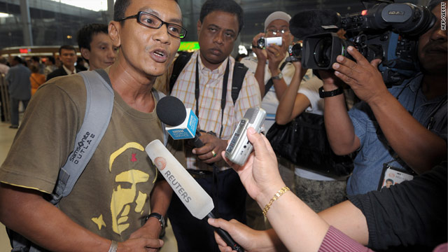 Human rights activist Zaw Lwin arrives at Bangkok airport Thursday after being released by the Myanmar authorities.