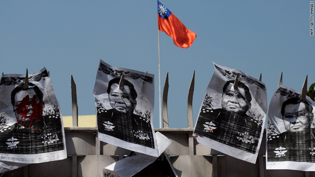 Posters bearing images of Myanmar junta leader General Than Shwe are pierced onto the main gate of the Myanmar Embassy during a protest in New Delhi on March 19, 2010, held to denounce Myanmar's recently announced election law.