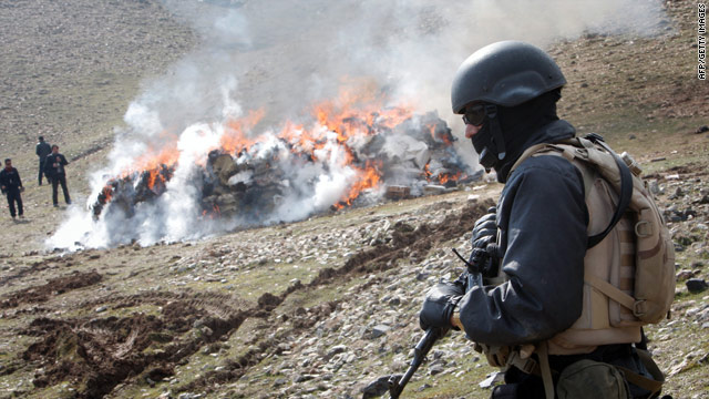 An Afghan police officer watches, as 16 tons of narcotics, including heroin and hashish, are burned outside Kabul on March 4.