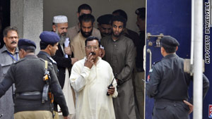 Five American terror suspects, surrounded by police and officials, leave court in Sargodha, Pakistan, on March 2.
