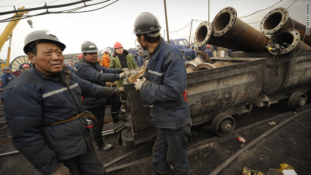 Mine workers prepare to send equipment 