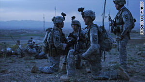 U.S. Army soldiers serve on night patrol in Afghanistan on Saturday.