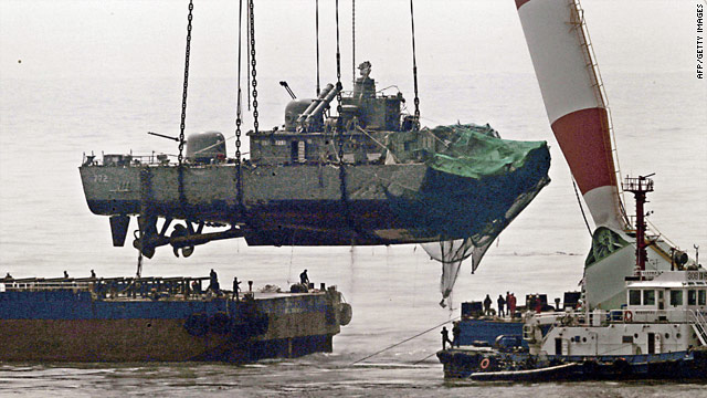A giant floating crane lifts the stern of the South Korean warship onto a barge.