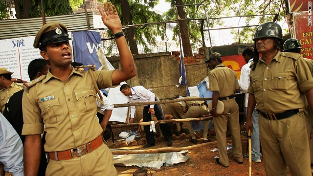 Police stand guard at the site of a low intensity blast at the gate at Chinnaswamy Stadium on April 17.