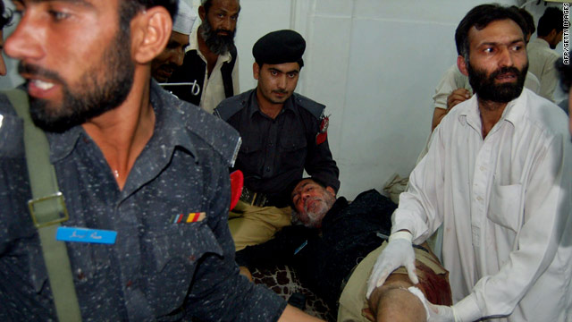 A paramedic treats an injured policeman at a hospital following a bomb blast in Peshawar on Monday.