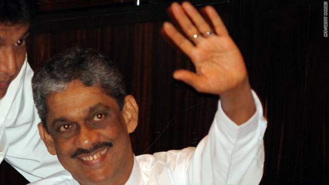 Detained General Sarath Fonseka arrives in Parliament in Colombo for the inauguration of the assembly on Thursday.