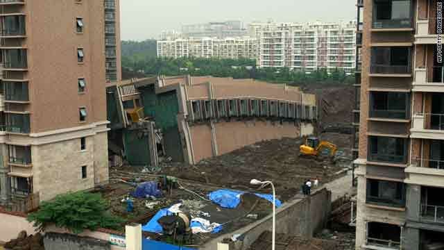 A 13-story residential building under construction in Shanghai lies on the ground after collapsing on June 27, 2009.