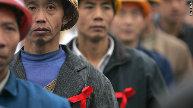 Migrant workers attend an event  to promote HIV/AIDS awareness December 1, 2005, in Chengdu of Sichuan Province.