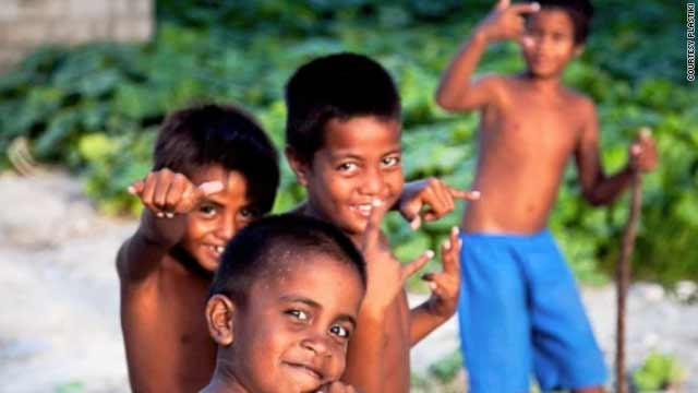 The photo from Matt Grey of the Plastiki expediton, shows kids on Christmas Island.