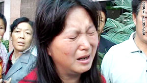 A Chinese woman cries after learning her child was killed in an attack on a kindergarten.