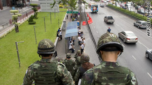 "Soldiers patrol the streets around the area of the ""Red Shirt"" fortified camp in Bangkok on Wednesday."