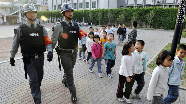 Security staff guard a kindergarten in Beijing following a spate of attacks on Chinese schools.