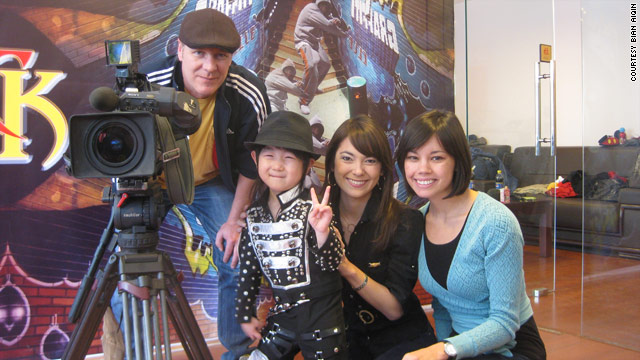 Four-year-old Wang Yiming poses with Emily Chang and the CNN crew.