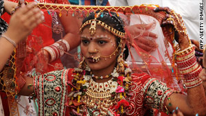 A Rajasthani woman takes part in a mass wedding ceremony during Akshaya Tritiya festivities in Ahmedabad.