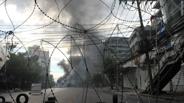 Fires burn on a boulevard near the Pratunam intersection in downtown Bangkok.