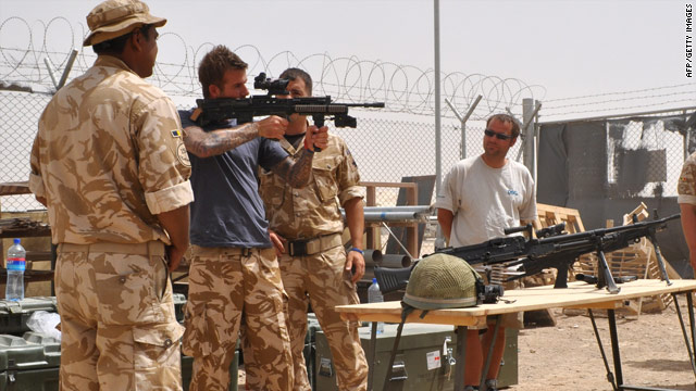 David Beckham is shown systems used by front line troops, during a visit to Camp Bastion, Afghanistan on May 22.